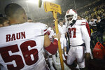 Wisconsin wide receiver Quintez Cephus (87) hands Paul Bunyan's Axe to teammate linebacker Zack Baun (56) after Wisconsin beat Minnesota 38-17 in an NCAA college football game Saturday, Nov. 30, 2019, in Minneapolis. (AP Photo/Stacy Bengs)