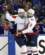 Washington Capitals right wing Tom Wilson (43) celebrates with defenseman Matt Niskanen (2) after Wilson scored against the Tampa Bay Lightning during the first period of Game 2 of the NHL Eastern Conference finals hockey playoff series Sunday, May 13, 2018, in Tampa, Fla. (AP Photo/Chris O'Meara)