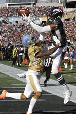AFC wide receiver Courtland Sutton, of the Denver Broncos, (14) attempts to hold onto a pass as NFC cornerback Darius Slay, of the Detroit Lions, (23) defends, during the first half of the NFL Pro Bowl football game, Sunday, Jan. 26, 2020, in Orlando, Fla. (AP Photo/Chris O'Meara)