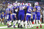 The Buffalo Bills huddle during an NFL game against the Dallas Cowboys, Thursday, Nov. 28, 2019 in Dallas. The Bills defeated the Cowboys 26-15. (Margaret Bowles via AP)