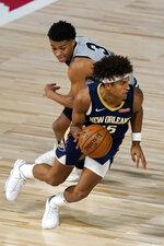 New Orleans Pelicans' Frank Jackson, right, drives around San Antonio Spurs' Keldon Johnson (3) during the second half of an NBA basketball game, Sunday, Aug. 9, 2020, in Lake Buena Vista, Fla. (AP Photo/Ashley Landis, Pool)