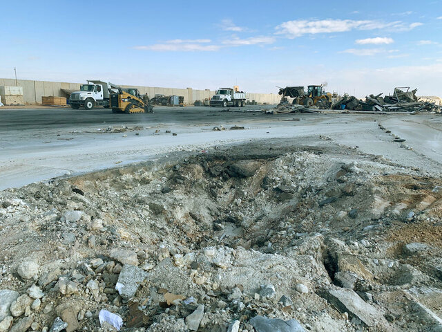 FILE - In this Jan. 13, 2020 file photo, Iranian bombing caused a crater at Ain al-Asad air base in Anbar, Iraq. Ain al-Asad air base was struck by a barrage of Iranian missiles, in retaliation for the U.S. drone strike that killed atop Iranian commander, Gen. Qassem Soleimani. The Pentagon now says 50 service members have been diagnosed with traumatic brain injury caused by the Jan. 8 Iranian missile attack on an air base in Iraq where U.S. and coalition troops had taken cover in advance. (AP Photo/Ali Abdul Hassan)