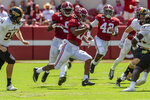 Alabama wide receiver Jaylen Waddle (17) breaks loose for a 41-yard punt return during the second half of an NCAA college football game against Southern Miss, Saturday, Sept. 21, 2019, in Tuscaloosa, Ala. (AP Photo/Vasha Hunt)