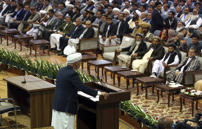 Afghan President Ashraf Ghani speaks during the first day of the Loya Jirga, or the consultative council in Kabul, Afghanistan, Monday, April 29, 2019. Afghanistan's president opened a grand council on Monday of more than 3,200 prominent Afghans seeking to agree on a common approach to peace talks with the Taliban, but the gathering may further aggravate divisions within the U.S.-backed government. (AP Photo/Rahmat Gul)