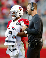 Arizona Cardinals quarterback Kyler Murray, left, talks with head coach Kliff Kingsbury during the second half of an NFL football game against the San Francisco 49ers in Santa Clara, Calif., Sunday, Nov. 17, 2019. (AP Photo/John Hefti)
