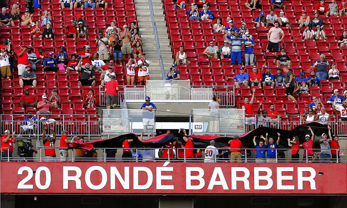 Former Tampa Bay Buccaneers player Ronde Barber's name is uncovered after he was inducted to the team's Ring of Honor during halftime of an NFL football game against the New York Giants Sunday, Sept. 22, 2019, in Tampa, Fla. (AP Photo/Mark LoMoglio)