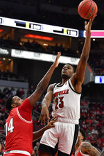 Louisville center Steven Enoch (23) shoots over Miami (Ohio) forward Bam Bowman (14) during the second half of an NCAA college basketball game in Louisville, Ky., Wednesday, Dec. 18, 2019. Louisville won 70-46. (AP Photo/Timothy D. Easley)