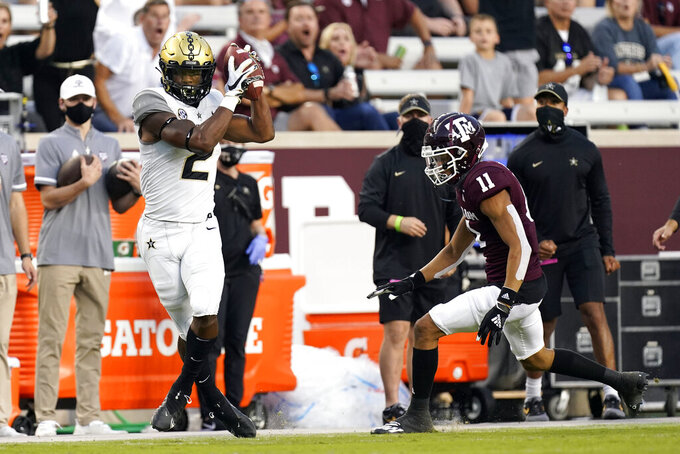 Vanderbilt wide receiver Amir Abdur-Rahman (2) catches a pass for a first down as Texas A&M defensive back Travon Fuller (11) defends during the first half of an NCAA college football game Saturday, Sept. 26, 2020, in College Station, Texas. (AP Photo/David J. Phillip)
