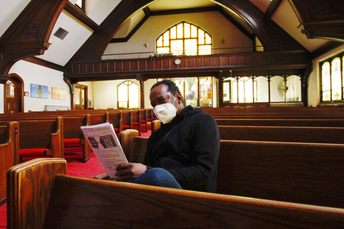 In this photo taken May 6, 2021, Michael Adkins sits in the sanctuary of St. Matthew Christian Methodist Episcopal Church, in Milwaukee, after receiving a vaccination. It's one of the churches that was part of an effort with Pastors United, Milwaukee Inner City Congregations Allied for Hope, Souls to the Polls and the local health clinic Health Connections to get people vaccinated directly in churches. (AP Photo/Carrie Antlfinger)