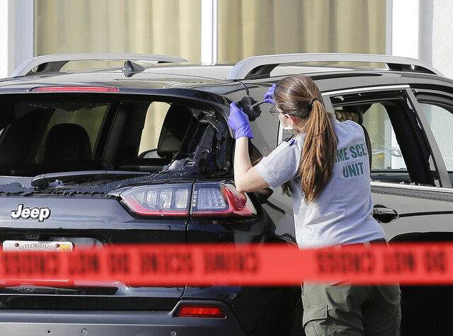 A forensic technician works on the vehicle authorities say officers fired shots at, that breached security at President Donald Trump's Mar-a-Lago resort in Palm Beach, Friday, Jan. 31, 2020, in West Palm Beach, Fla. (AP Photo/Terry Renna)