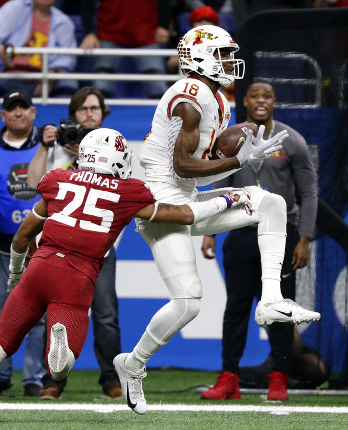 Iowa State wide receiver Hakeem Butler (18) makes a catch in front of Washington State safety Skyler Thomas (25) during the second half of the Alamo Bowl NCAA college football game Friday, Dec. 28, 2018, in San Antonio. (AP Photo/Eric Gay)