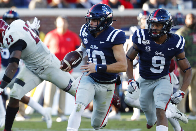 Mississippi quarterback John Rhys Plumlee (10) outruns his blockers as he has a long run for a first down against New Mexico State during the first half of an NCAA college football game in Oxford, Miss., Saturday, Nov. 9, 2019. (AP Photo/Rogelio V. Solis)