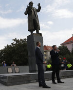 In this file picture taken on Tuesday, Aug. 21, 2018, Prague 6 district representatives unveil a new explanatory text about the role of Soviet World War II commander Ivan Stepanovic Konev at his monument in Prague, Czech Republic. A Prague district is set to remove a statue of a Soviet World War II commander Ivan Konev from its site, a move that will likely anger Russia. After it was targeted by vandals, Prague 6 approved Thursday, Sept. 12, 2019 a plan to remove it.  (AP Photo/Petr David Josek/File)