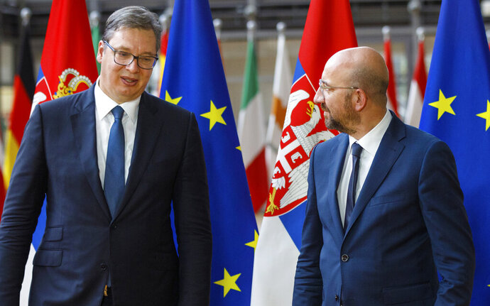 FILE - In this Friday, June 26, 2020 file photo, European Council President Charles Michel, right, greets Serbian President Aleksandar Vucic prior to a meeting at the European Council building in Brussels. The leaders of Serbia and Kosovo committed Monday, Sept. 7, 2020 to European Union-brokered talks on normalizing their strained ties and appeared to play down the importance of a surprise announcement last week by U.S. President Donald Trump that they are beefing up economic cooperation. (AP Photo/Olivier Matthys, Pool, File)
