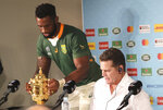 South Africa's Siya Kolisi places the Webb Ellis Cup next to coach Rassie Erasmus at a press conference after they defeated England in Rugby World Cup final at International Yokohama Stadium in Yokohama, Japan, Saturday, Nov. 2, 2019. (AP Photo/Koji Sasahara)