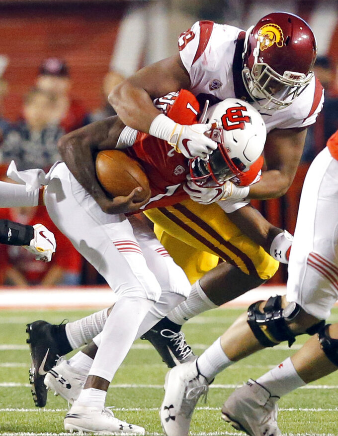 Utah quarterback Tyler Huntley (1) is sacked by Southern California defensive lineman Christian Rector (89) during the first half of an NCAA college football game Saturday, Oct. 20, 2018, in Salt Lake City. (AP Photo/Rick Bowmer)