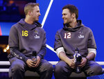 FILE - In this Monday, Jan. 28, 2019, file photo, Los Angeles Rams' Jared Goff talks to New England Patriots' Tom Brady during Opening Night for the NFL Super Bowl 53 football game in Atlanta. The wide-eyed, talented Goff will try to lead his Rams past the grizzled, 41-year-old Brady, who is looking to guide the Patriots to their sixth Super Bowl victory.   (AP Photo/Matt Rourke, File)