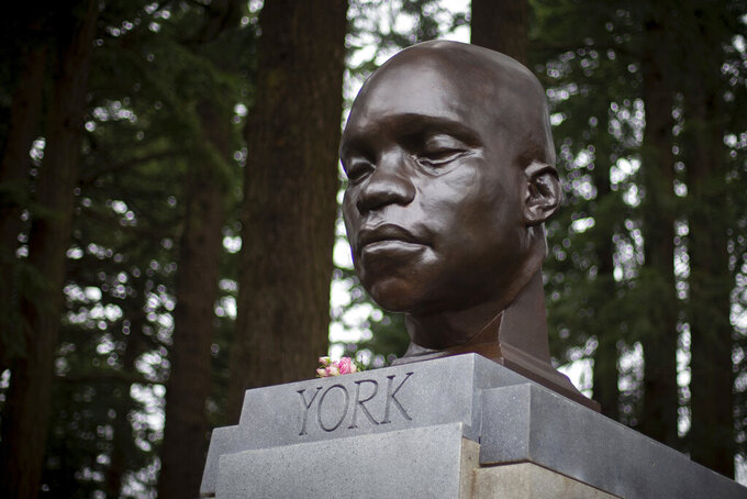 FILE - In this Sunday Feb. 21, 2021, file photo, the bust of York is seen on Mount Tabor in southeast Portland, Ore. Officials say the bust of York, commemorating an enslaved Black member of the Lewis and Clark Expedition was toppled and damaged. A Portland Parks and Recreation spokesperson told KOIN 6 News that the bust of York was torn from its pedestal and significantly damaged Tuesday night, July 27, or early Wednesday. (Mark Graves/The Oregonian via AP, File)