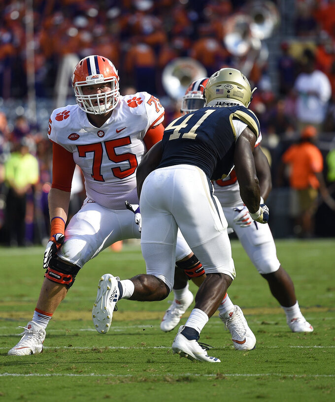 FILE - In this Sept. 22, 2018, file photo, Clemson offensive tackle Mitch Hyatt (75) works against Georgia Tech during the first half of an NCAA college football game,  in Atlanta. No. 2 Clemson once again dominated the Associated Press All-Atlantic Coast Conference teams and individual awards released Tuesday, Dec. 4, 2018. Mitch Hyatt was a unanimous pick for the second straight year. (AP Photo/Jon Barash, File)