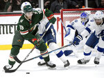 Minnesota Wild's Luke Kunin (19) works the puck against Tampa Bay Lightning's Jan Rutta (44), of the Czech Republic, and Victor Hedman (77), of Sweden, during the second period of an NHL hockey game Thursday, Jan. 16, 2020, in St. Paul, Minn. (AP Photo/Hannah Foslien)