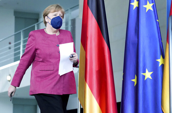 German Chancellor Angela Merkel arrives for a press conference at the Chancellery in Berlin, Germany, Friday, May 21, 2021 following the virtual 'Global Health Summit'. (AP Photo/Michael Sohn, pool)