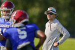 Oklahoma head coach Lincoln Riley watches during an NCAA college football practice, Tuesday, Aug. 10, 2021, in Norman, Okla. (AP Photo/Sue Ogrocki)