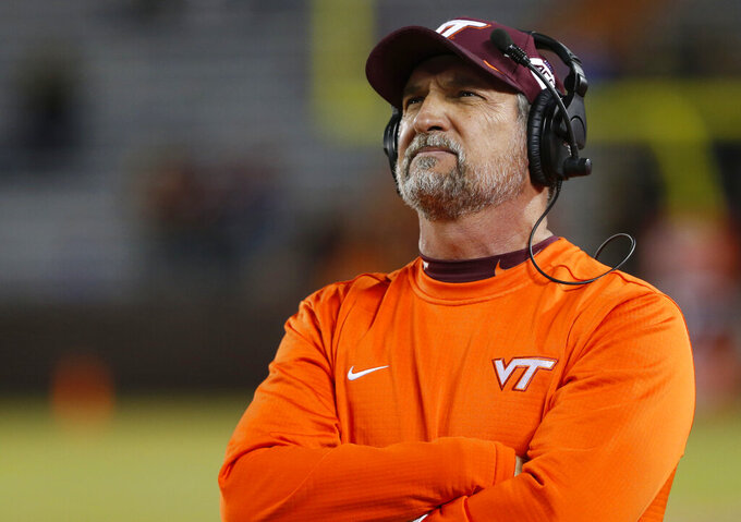 "FILE - In this Oct. 25, 2019, file photo, Virginia Tech defensive coordinator Bud Foster looks at the scoreboard during the second half of the team's NCAA college football game against Georgia Tech in Blacksburg, Va. The Hokies are honoring Foster before the game against Wake Forest on Saturday, Nov. 9, with ""Bud Foster Day."" Foster, who has kept the Virginia Tech defense among the nation's best for many of his 33 years at the school, is retiring after this season. (AP Photo/Steve Helber, File)"
