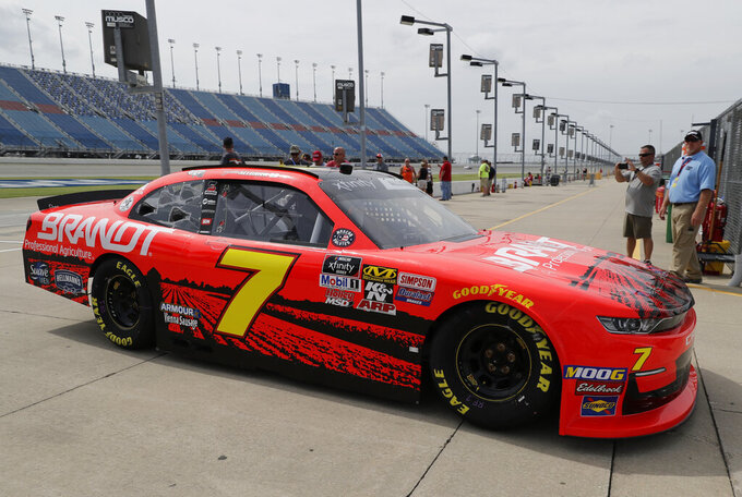 Justin Allgaier drives to his garage during a NASCAR Xfinity Series auto race practice at Chicagoland Speedway in Joliet, Ill., Friday, June 28, 2019. (AP Photo/Nam Y. Huh)