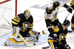 Pittsburgh Penguins goaltender Matt Murray (30) blocks a shot with Boston Bruins' David Backes (42) looking for a rebound during the first period of an NHL hockey game in Pittsburgh, Sunday, March 10, 2019. (AP Photo/Gene J. Puskar)
