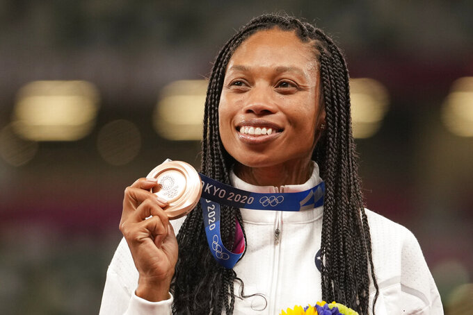 FILE - Bronze medalist Allyson Felix, of the United States, poses during the medal ceremony for the women's 400-meter run at the 2020 Summer Olympics in Tokyo, in this Friday, Aug. 6, 2021, file photo. Olympians Allyson Felix and Jordan Larson were honored as Sportswomen of the Year by the Women's Sports Foundation at the Annual Salute to Women in Sports on Wednesday night, Oct. 13, 2021, in New York. (AP Photo/Martin Meissner, File)