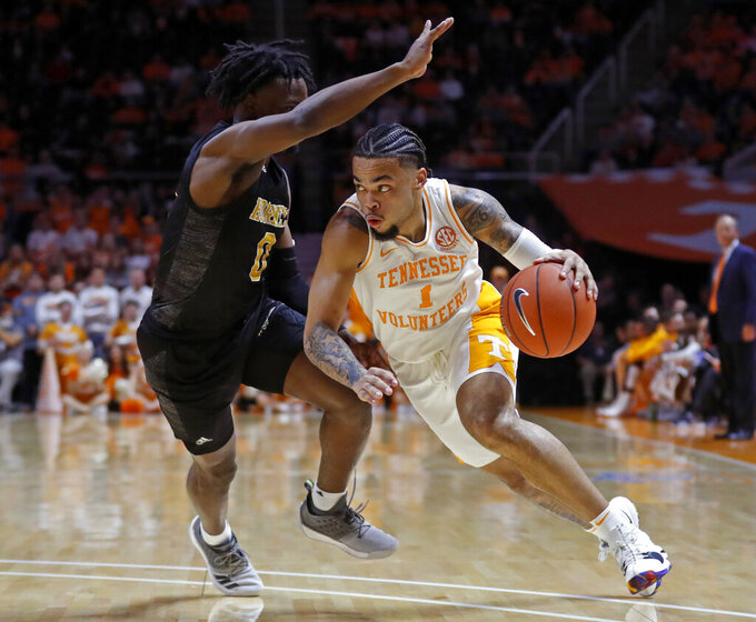 Tennessee guard Lamonte Turner (1) drives against Alabama State guard D.J. Heath (0) during the first half of an NCAA college basketball game Wednesday, Nov. 20, 2019, in Knoxville, Tenn. (AP Photo/Wade Payne)