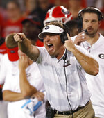 Georgia head coach Kirby Smart yells from the sideline during the first half of the team's NCAA college football game against Vanderbilt on Saturday, Oct. 6, 2018, in Atlanta. (AP Photo/John Bazemore)