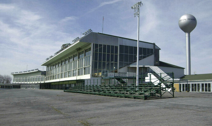FILE - This March 30, 2004 file photo, shows the grand stands at Vernon Downs in Verona, N.Y.  Oneida County Sheriff Rob Maciol is among the local officials and residents expressing concerns about upstate New York's Vernon Downs harness track and casino hosting the 50th anniversary Woodstock festival Aug. 16-18. Vernon Downs could host up to 65,000 people, as opposed to the 150,000 planned for Watkins Glen, and it would not feature camping. (AP Photo/Kevin Rivoli, File)