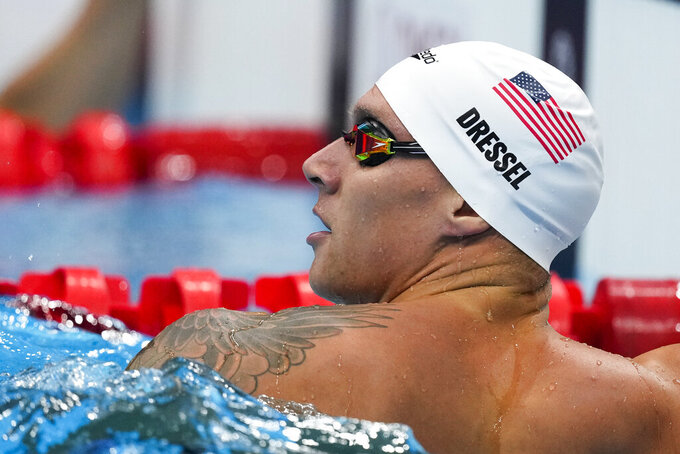 Caeleb Dressel, of the United States, reacts after winning a heat of the men's 100-meter butterfly at the 2020 Summer Olympics, Thursday, July 29, 2021, in Tokyo, Japan. (AP Photo/Charlie Riedel)