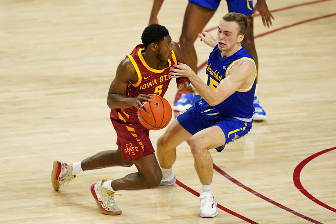 Iowa State guard Jalen Coleman-Lands drives around South Dakota State guard Noah Freidel, right, during the second half of an NCAA college basketball game, Wednesday, Dec. 2, 2020, in Ames, Iowa. South Dakota State won 71-68. (AP Photo/Charlie Neibergall)