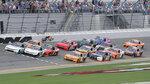 Justin Haley, front left, edges out A J Allmendinger, center right, to win the NASCAR Xfinity Series auto race at Daytona International Speedway, Saturday, Aug. 28, 2021, in Daytona Beach, Fla. (AP Photo/Phelan M. Ebenhack)