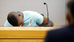 FILE - In this Tuesday, Sept. 24, 2019, file photo, Joshua Brown, a neighbor of victim Botham Jean, is overcome with emotion while giving testimony in court, in Dallas, after recounting how he'd heard Jean singing gospel and Drake songs across the hall before he was fatally shot. Authorities say that Brown was killed in a shooting Friday, Oct. 4. (Tom Fox/The Dallas Morning News via AP, Pool, File)
