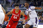 Houston's Quentin Grimes (24) drives to the basket past East Carolina's J.J. Miles (11) during the second half of an NCAA college basketball game in Greenville, N.C., Wednesday, Jan. 29, 2020. (AP Photo/Karl B DeBlaker)