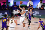 Denver Nuggets' Jamal Murray (27) shoots ahead of Los Angeles Lakers' Danny Green (14) during the second half of an NBA conference final playoff basketball game Saturday, Sept. 26, 2020, in Lake Buena Vista, Fla. (AP Photo/Mark J. Terrill)