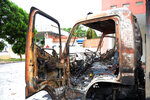 In this photo taken on Tuesday June 12, 2018, a charred truck is seen at the fire and police station in the south central province of Binh Thuan, Vietnam. Vietnamese protesters clashed with police on Sunday and Monday in the province to protest over a proposed law on special economic zones they fear will be dominated by Chinese investors. The National Assembly on Monday voted to put on hold the legislation for several months. State media reported that police in the south central province of Binh Thuan on Sunday night used tear gas and water cannons but failed to prevent protesters from entering a government building they later vandalized. (AP Photo)