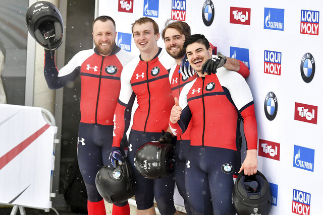 Third placed Hunter Church, Joshua Williamson, James Reed and Kristopher Horn of the United States pose for media after the men's four-man bobsled World Cup race in Igls, near Innsbruck, Austria, Sunday, Jan. 19, 2020. (AP Photo/Kerstin Joensson)