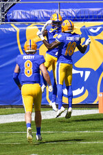 Pittsburgh wide receiver Jordan Addison, center, celebrates with Shockey Jacques-Louis (18) after making a touchdown catch from quarterback Kenny Pickett (8) during the first half of an NCAA college football game against Syracuse, Saturday, Sept. 19, 2020, in Pittsburgh. (AP Photo/Keith Srakocic)