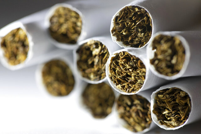 FILE - This Dec. 17, 2019 photo shows a group of cigarettes in New York.  About 14% of U.S adults were cigarette smokers last year, for the third year in a row. Meanwhile, the adult vaping rate still appears to be rising, according to a new government report. (AP Photo/Patrick Sison)