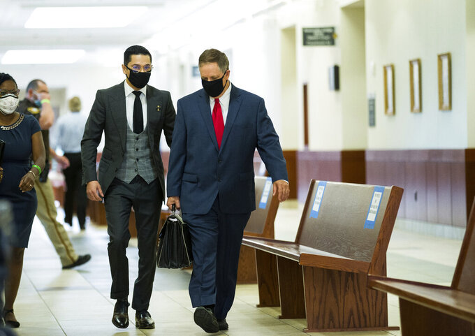 Victor Hugo Cuevas, a 26-year-old linked to a missing tiger named India, arrives at the Fort Bend County Justice Center for a bond revocation hearing on a separate murder charge, on Friday, May 14, 2021, in Richmond, Texas.   Prosecutors in Fort Bend County are seeking to revoke a bond for Victor Hugo Cuevas after he was charged with murder in a 2017 fatal shooting.  (Godofredo A. Vásquez/Houston Chronicle via AP)