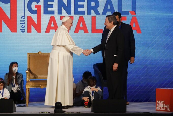 Pope Francis shakes hands with Italian premier Mario Draghi at a conference on the Demographic Crisis in Rome Friday, May 14, 2021. Pope Francis added his voice Friday to the chorus of alarm about Italy's demographic crisis, calling for government policies that provide the necessary financial stability to encourage young people to stay in Italy and have families. (AP Photo/Andrew Medichini)