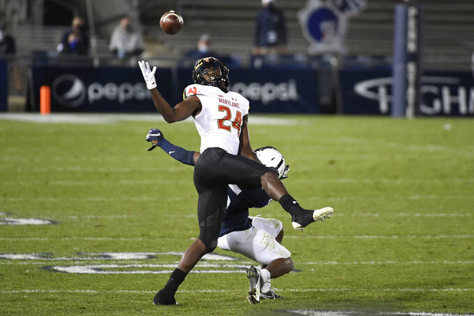 Maryland defensive back Kenny Bennett (24) intercepts a pass intended for Penn State wide receiver Jahan Dotson (5) in the fourth quarter of an NCAA college football game in State College, Pa., Saturday, Nov. 7, 2020. (AP Photo/Barry Reeger)