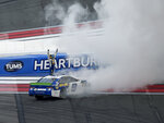 Chase Elliott (9) celebrates after winning a NASCAR Cup Series auto race at Charlotte Motor Speedway, Sunday, Sept. 29, 2019, in Concord, N.C. (AP Photo/Mike McCarn)