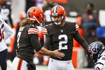 Cleveland Browns kicker Cody Parkey (2) is congratulated by Jamie Gillan after Parkey kicked a 41-yard field goal during the first half of an NFL football game against the Houston Texans, Sunday, Nov. 15, 2020, in Cleveland. The Cleveland Browns were forced to place three more players, including starting right tackle Jack Conklin and kicker Cody Parkey, on the COVID-19 list Wednesday, Nov. 18, 2020, as they prepare for this week's home game against Philadelphia.(AP Photo/Ron Schwane)