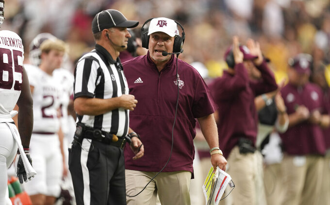 FILE - In this Saturday, Sept. 11, 2021 file photo, Texas A&M head coach Jimbo Fisher argues with a referee in the second half of an NCAA college football game against Colorado in Denver. Texas A&M plays Arkansas on Saturday, Sept. 25, 2021. (AP Photo/David Zalubowski, File)