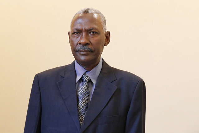Maj. Gen. Yassin Ibrahim Yassin poses for a portrait after taking the oath as Minister of Defense at the Presidential Palace in Khartoum, Sudan, Tuesday, June 2, 2020. The ceremony came more than two months after the death of the former defense chief and amid tensions with neighboring Ethiopia. (AP Photo/Marwan Ali)